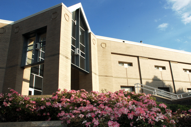 Food Sciences Building with pink roses in bloom