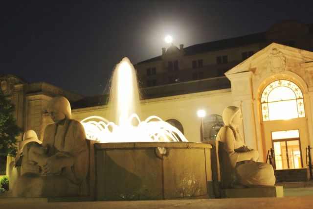 Fountain of the four seasons with the full moon in the background
